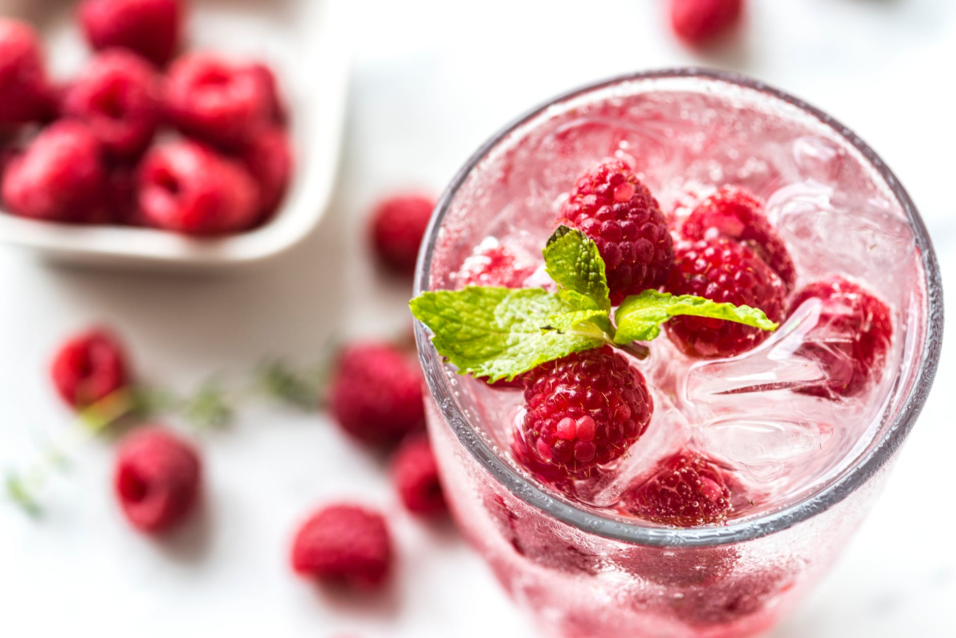 water topped with raspberries