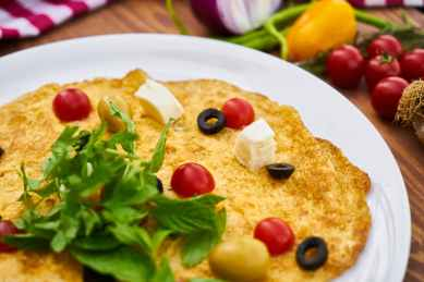 selective focus photography of omelette with toppings