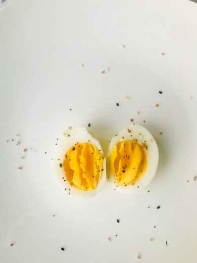 sliced boiled egg on white plate